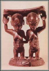 This wooden headrest from Zaire portrays twins, which had a special significance in African mythology. They were thought to represent the balance between opposing forces that existed in the natural world.