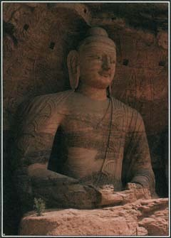 This enormous statue of the Buddha is carved into a cliff at the Yungang Caves near Datong, China.