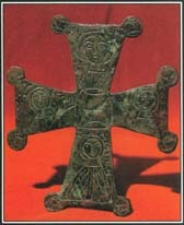 The four equal bars of the Greek cross may represent the four cardinal directions (north, south, east, and west) or the four basic elements (earth, water, wind, and fire).