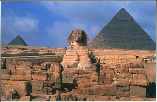 Pyramids were built to honor the powerful kings of Egypt and to give them a home and provisions in the afterlife. Here, two pyramids of Giza rise above the Great Sphinx.