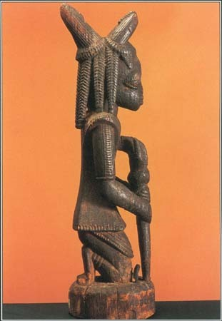This carved wood sculpture shows Eshu, the trickster god of the Yoruba people of Nigeria in West Africa.