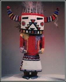 The Hopi and other Pueblo peoples use kachina dolls to teach their children about divine and ancestral spirits. These wooden figures are often elaborately carved and adorned; this one has horns and feathers.