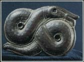 This Norse brooch of the 600s shows Jormungand, the serpent that encircles the world in Norse mythology. In one story, the god Thor tries to drain the ocean and remove the World Serpent.